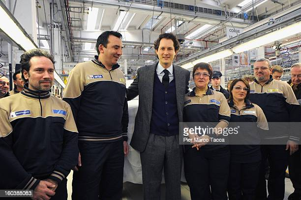 President of FIAT John Elkann poses with the workers during the unveiling of the Maserati Plant in Grugliasco dedicated to Gianni Agnelli on January...