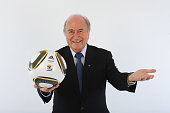 President of FIFA Sepp Blatter presents the official match ball for the FIFA World Cup 2010 on December 4 2009 in Cape Town South Africa