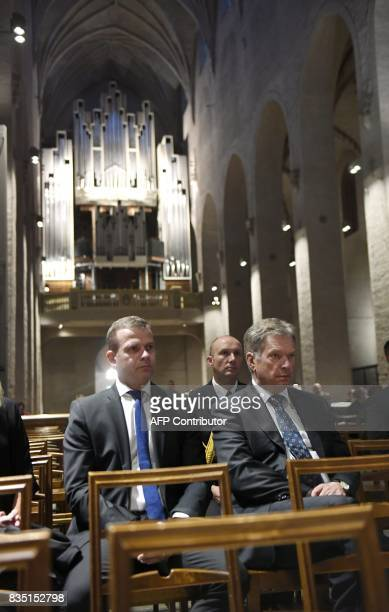 President of Finland Sauli Niinisto and Finland's Minister of Finance Petteri Orpo attend a prayer service at the Turku Cathedral for the victims of...