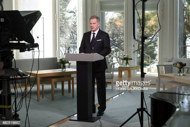 President of Finland Sauli Niinisto prepares to give a televised memorial speech at the presidential residence Mantyniemi in Helsinki on May 13 in...
