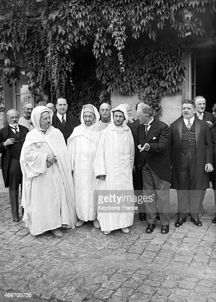 President of France Albert Lebrun talking to Sultan Mohammed V of Morocco at the castle of Rambouillet with left Si Kaddour Ghabrit rector of the...