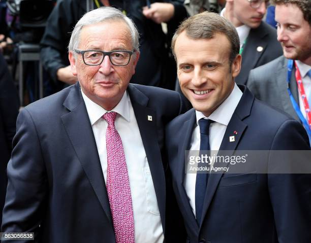 President of France Emmanuel Macron and President of the European Commission JeanClaude Juncker pose for a photograph as they attend the European...