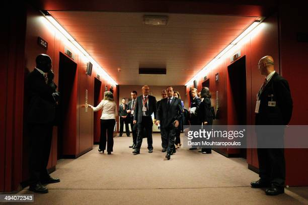 President of France Francois Hollande walks to his room to speak to the media after the Informal Dinner of Heads of State or Government held at the...