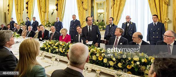 President of France François Hollande gives a speech during a lunch with Dutch King WillemAlexander Dutch Minister Frans Timmermans of Foreign...