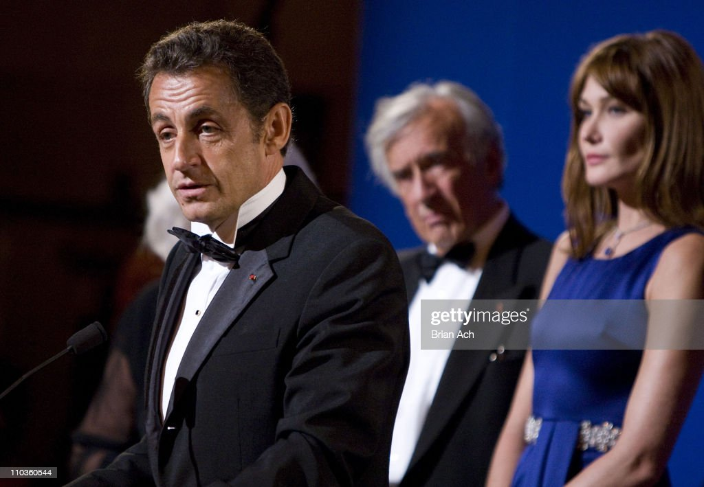 President of France Nicolas Sarkozy, author and humanitarian Elie Wiesel, and first lady of France Carla Bruni at the Elie Wiesel Foundation for Humanity to Honor French President Nicolas Sarkozy event at Cipriani on September 22, 2008 in New York City.