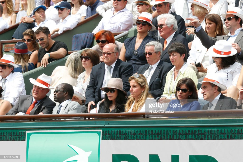 President of France Television Remy Pflimlin and his wife, President of the Confederation of African Tennis Diagna Ndiaye, French Minister <a gi-track='captionPersonalityLinkClicked' href=/galleries/search?phrase=Yamina+Benguigui&family=editorial&specificpeople=615509 ng-click='$event.stopPropagation()'>Yamina Benguigui</a>, former tennis player Arantxa Sanchez Vicario, Anne Hidalgo, President of FFT <a gi-track='captionPersonalityLinkClicked' href=/galleries/search?phrase=Jean+Gachassin&family=editorial&specificpeople=5701397 ng-click='$event.stopPropagation()'>Jean Gachassin</a>, (3rd Row R) <a gi-track='captionPersonalityLinkClicked' href=/galleries/search?phrase=Jean-Loup+Dabadie&family=editorial&specificpeople=2365886 ng-click='$event.stopPropagation()'>Jean-Loup Dabadie</a> and his wife Veronique sighting at Roland Garros Tennis French Open 2013 - Day 14 on June 8, 2013 in Paris, France.