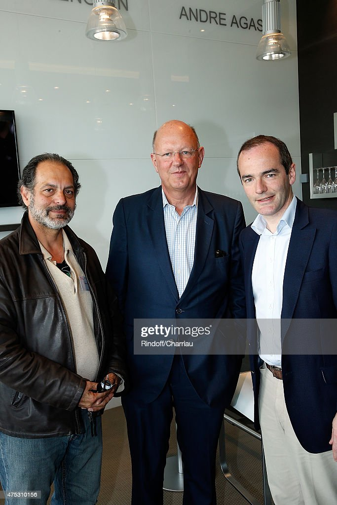 President of France Television Remy Pflimlin (C) and Journalist historian Franck Ferrand attend the French Tennis Open 2015 at Roland Garros on May 30, 2015 in Paris, France.