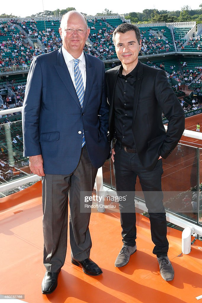 President of France Television Remy Pflimlin and Sports journalist Laurent Luyat pose at France Television french chanels studio at the Roland Garros French Tennis Open 2014 - Day 14 on June 7, 2014 in Paris, France.