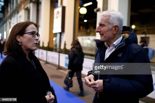 President of France Televisions Delphine Ernotte Cunci speaks with head of the French national stateowned railway company SNCF Guillaume Pepy as she...
