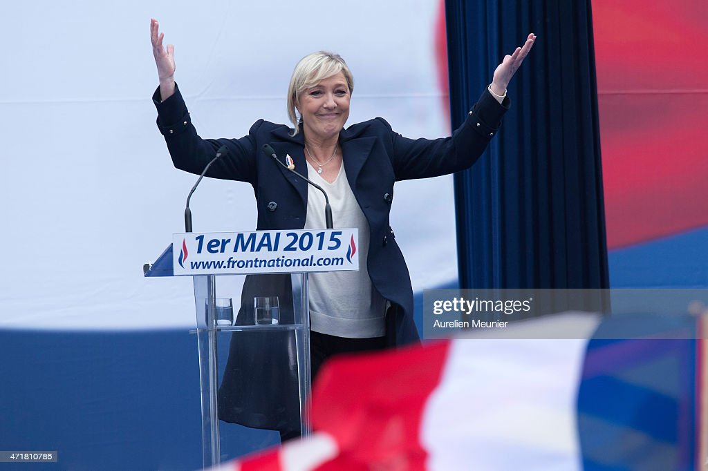President of France's far right party the Front National (FN), Marine Le Pen addresses the crowd during the party's annual rally honoring Joan of Arc on Place de l'Opera, on May 1, 2015 in Paris, France. Every year over 1000 people from the FN Party demonstrate on May 1st.