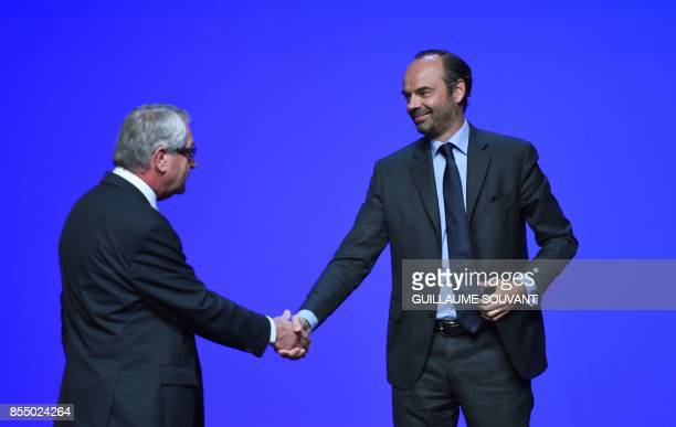 President of France's regions and head of the Grand Est regional council Philippe Richert shakes hands with French Prime Minister Edouard Philippe...