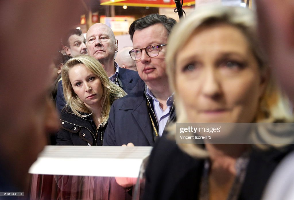 President of French far right Front National (FN) party <a gi-track='captionPersonalityLinkClicked' href=/galleries/search?phrase=Marine+Le+Pen&family=editorial&specificpeople=588282 ng-click='$event.stopPropagation()'>Marine Le Pen</a> (R) and neice Front National MP <a gi-track='captionPersonalityLinkClicked' href=/galleries/search?phrase=Marion+Marechal-Le+Pen&family=editorial&specificpeople=6562007 ng-click='$event.stopPropagation()'>Marion Marechal-Le Pen</a> visit the Salon de l Agriculture (Agricultural Show) at Parc des Expositions Porte de Versailles on March 1, 2016 in Paris, France.