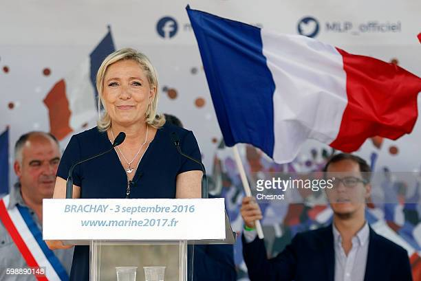President of French farright Front National party Marine Le Pen delivers a speech during a political rally on September 3 2016 in Brachay France...
