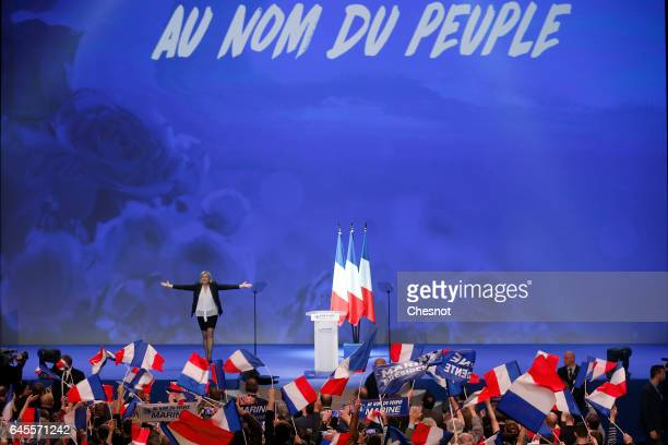 President of French farright Front National party Marine Le Pen acknowledges the public at the end of a campaign rally on February 26 2017 in Nantes...