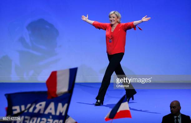 President of French farright Front National party Marine Le Pen gestures prior to a campaign rally on March 11 2017 in Chateauroux France Marine Le...