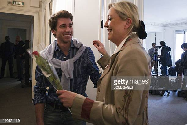 President of French farright party Front national and candidate for the 2012 French presidential election Marine Le Pen smiles as Julien Roshedy...