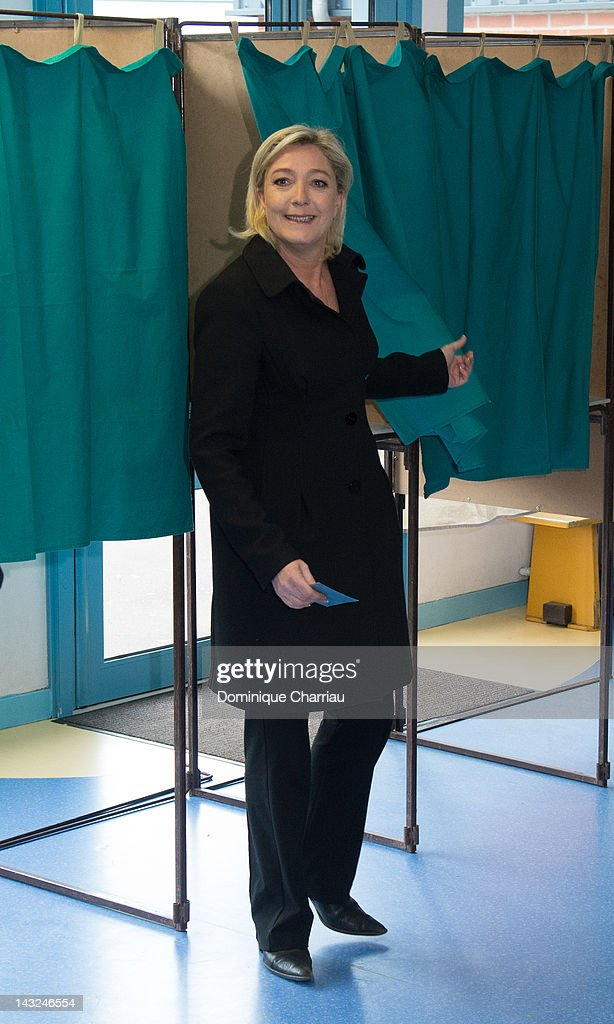 President of French farright party Front national and candidate for the 2012 French presidential election Marine Le Pen casts her vote at a polling...