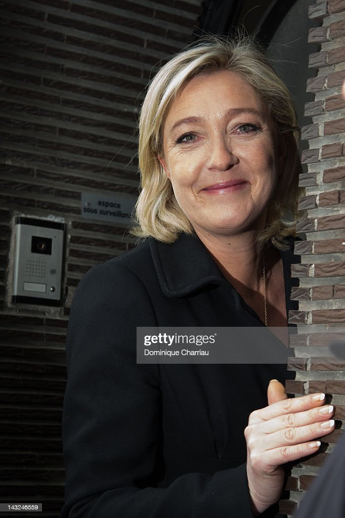 President of French farright party Front national and candidate for the 2012 French presidential election Marine Le Pen leaves a polling station...