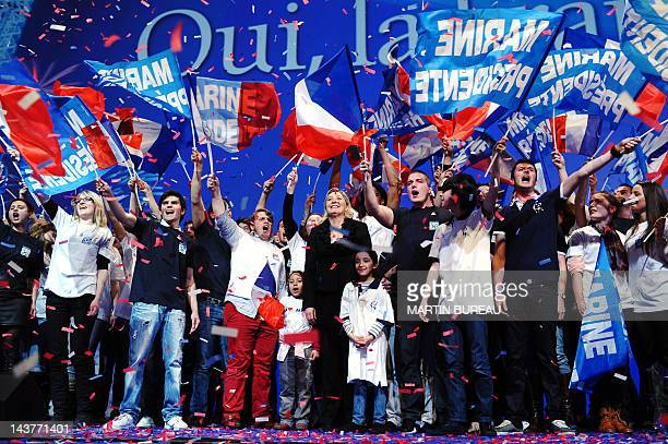 President of French farright party Front national and candidate for the 2012 French presidential election Marine Le Pen smiles to the audience...