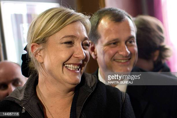 President of French farright party Front national and candidate for the 2012 French presidential election Marine Le Pen flanked by her companion and...
