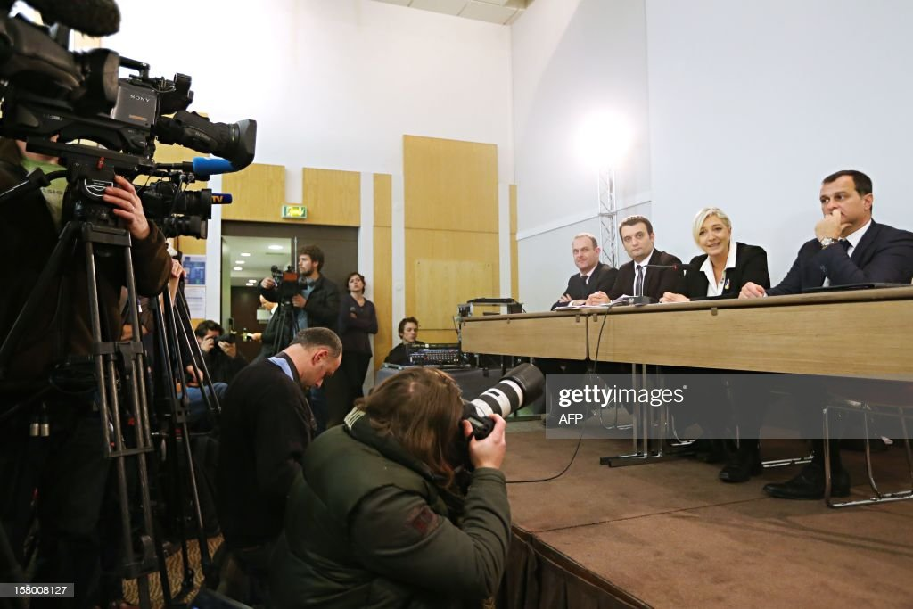President of French far-right party Front national (FN), Marine Le Pen (2ndR) speaks in front of journalists during a press conference following the party's national congress on December 8, 2012 in Paris. Near Marine Le Pen are Party's General secretary Steeve Briois (L), vice-President, Florian Philippot (2-L) and Louis Alliot (R). AFP PHOTO THOMAS SAMSON