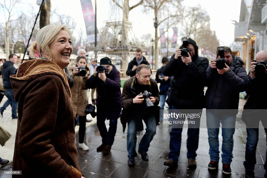 President of French far-right party Front national (FN), Marine Le Pen, is pictured as she arrives on the Champs-Elysees avenue in Paris, to visit a Christmas market, on December 18, 2012.