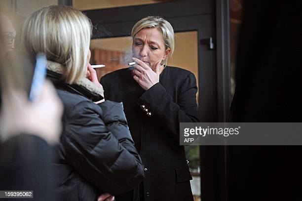 President of French farright party Front national Marine Le Pen takes a cigarette break following a press conference focused on Paris' march which...