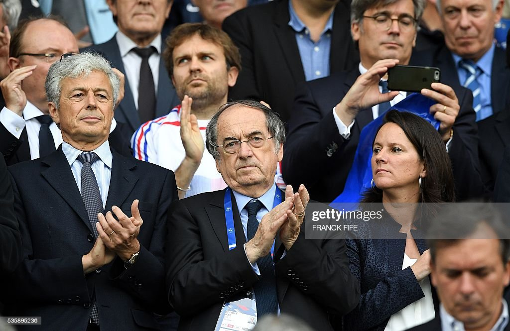 President of French Football Federation (FFF), Noel Le Graet (C), applauds during the friendly football match between France and Cameroon, at the Beaujoire Stadium in Nantes, western France, on May 30, 2016. / AFP / FRANCK