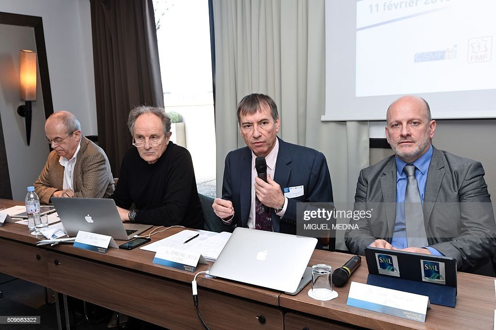 President of French medical services union the ' Confederation des Syndicats Medicaux Francais' (CSMF) , Jean-Paul Ortiz (2-R) prepares to respond to questions as Dr. Bertrand de Rochambeau (L), President of the Federation of French Doctors (FMF), Jean-Paul Hamon (2-L) and president of the SML doctors union Eric Henry look on during a press conference in Paris on February 11, 2016. / AFP / MIGUEL MEDINA