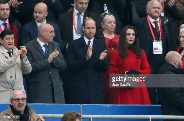 President of French Rugby Federation Bernard Laporte Prince William and Kate Middleton applaud following the RBS 6 Nations rugby match between France...