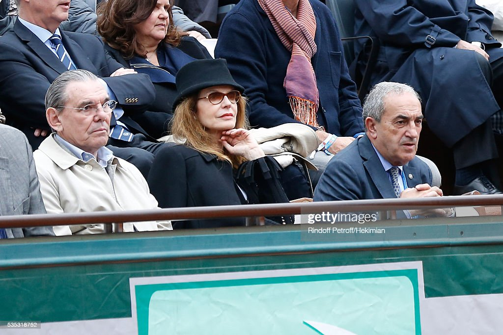 President of French Tennis Federation <a gi-track='captionPersonalityLinkClicked' href=/galleries/search?phrase=Jean+Gachassin&family=editorial&specificpeople=5701397 ng-click='$event.stopPropagation()'>Jean Gachassin</a> (R), actress Cyrielle Clair (2nd R) and her husband President of Forest Hill Michel Corbiere (3rd R) attend Day Height of the 2016 French Tennis Open at Roland Garros on May 29, 2016 in Paris, France.