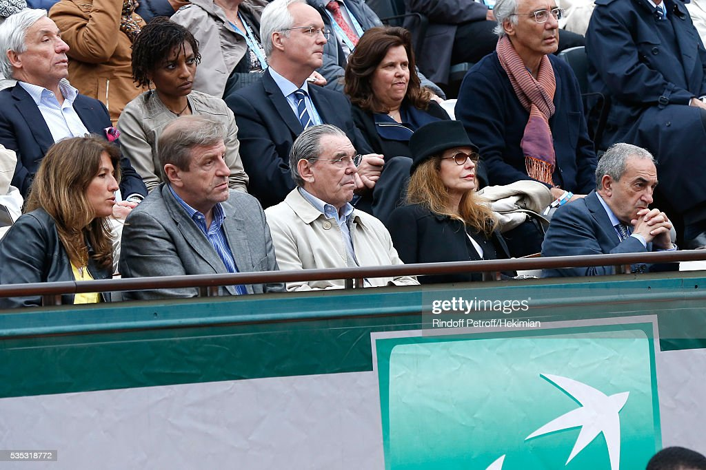 President of French Tennis Federation Jean Gachassin (R), actress Cyrielle Clair (2nd R) and her husband President of Forest Hill Michel Corbiere (3rd R) attend Day Height of the 2016 French Tennis Open at Roland Garros on May 29, 2016 in Paris, France.