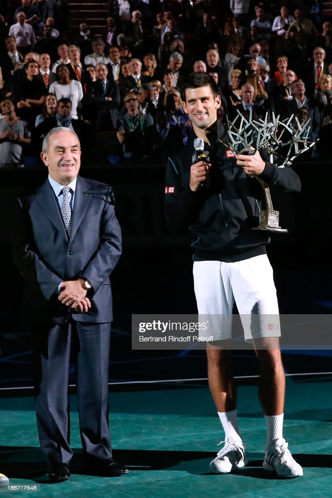 President of French Tennis Federation <a gi-track='captionPersonalityLinkClicked' href=/galleries/search?phrase=Jean+Gachassin&family=editorial&specificpeople=5701397 ng-click='$event.stopPropagation()'>Jean Gachassin</a> and <a gi-track='captionPersonalityLinkClicked' href=/galleries/search?phrase=Novak+Djokovic&family=editorial&specificpeople=588315 ng-click='$event.stopPropagation()'>Novak Djokovic</a> after Djokovic won against Ferrer in the final of the BNP Paribas Tennis Masters, day seven, at Palais Omnisports de Bercy on November 3, 2013 in Paris, France.