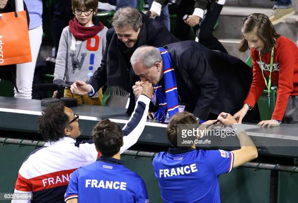 President of French Tennis Federation Jean Gachassin and VicePresident of FFT JeanPierre Dartevelle congratulate captain of Team France Yannick Noah...