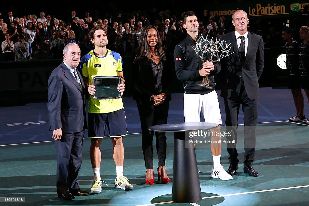 President of French Tennis Federation <a gi-track='captionPersonalityLinkClicked' href=/galleries/search?phrase=Jean+Gachassin&family=editorial&specificpeople=5701397 ng-click='$event.stopPropagation()'>Jean Gachassin</a>, <a gi-track='captionPersonalityLinkClicked' href=/galleries/search?phrase=David+Ferrer&family=editorial&specificpeople=208197 ng-click='$event.stopPropagation()'>David Ferrer</a>, Olympic Champion of fencing Laura Flessel, <a gi-track='captionPersonalityLinkClicked' href=/galleries/search?phrase=Novak+Djokovic&family=editorial&specificpeople=588315 ng-click='$event.stopPropagation()'>Novak Djokovic</a> and former french tennis player <a gi-track='captionPersonalityLinkClicked' href=/galleries/search?phrase=Guy+Forget&family=editorial&specificpeople=235573 ng-click='$event.stopPropagation()'>Guy Forget</a> after Djokovic won against Ferrer in the final of the BNP Paribas Tennis Masters, day seven, at Palais Omnisports de Bercy on November 3, 2013 in Paris, France.