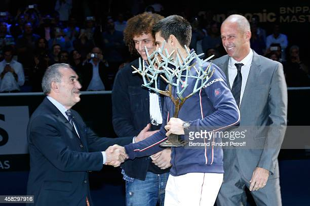 President of French Tennis Federation Jean Gachassin Football player David Luiz winner of the tournament Novak Djokovic and Director of the BNP...