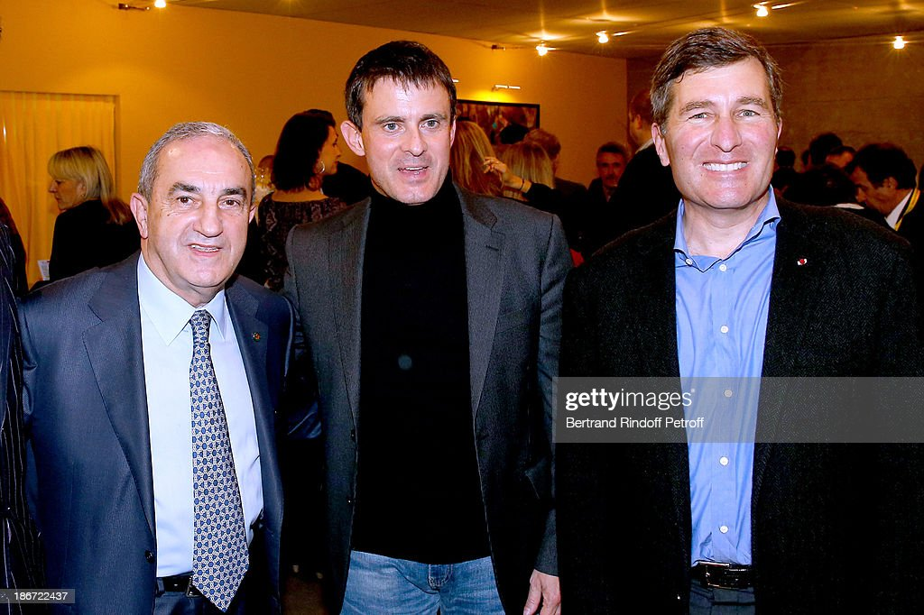 President of French Tennis Federation <a gi-track='captionPersonalityLinkClicked' href=/galleries/search?phrase=Jean+Gachassin&family=editorial&specificpeople=5701397 ng-click='$event.stopPropagation()'>Jean Gachassin</a>, Minister of the Interior <a gi-track='captionPersonalityLinkClicked' href=/galleries/search?phrase=Manuel+Valls&family=editorial&specificpeople=2178864 ng-click='$event.stopPropagation()'>Manuel Valls</a> and Ambassador of USA <a gi-track='captionPersonalityLinkClicked' href=/galleries/search?phrase=Charles+Rivkin&family=editorial&specificpeople=4891546 ng-click='$event.stopPropagation()'>Charles Rivkin</a> attend the final of the BNP Paribas Tennis Masters - day seven, at Palais Omnisports de Bercy on November 3, 2013 in Paris, France.