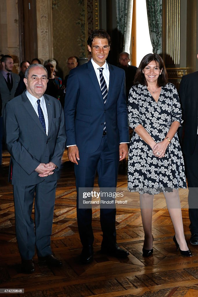 President of French Tennis Federation Jean Gachassin, Tennis Player Rafael Nadal and Mayor of Paris Anne Hidalgo attend Anne Hidalgo Awards the 'Grand Vermeil' Medal to Rafael Nadal at Mairie de Paris on May 21, 2015 in Paris, France.