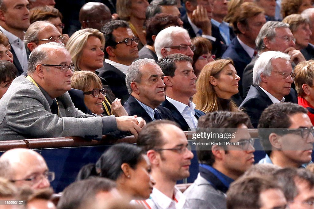 President of French Tennis Federation Jean Gachassin with his wife and Minister of the Interior Manuel Valls with his wife violinist Anne Gravoin attend day five of BNP Paribas Tennis Masters held at Bercy on November 1, 2013 in Paris, France.