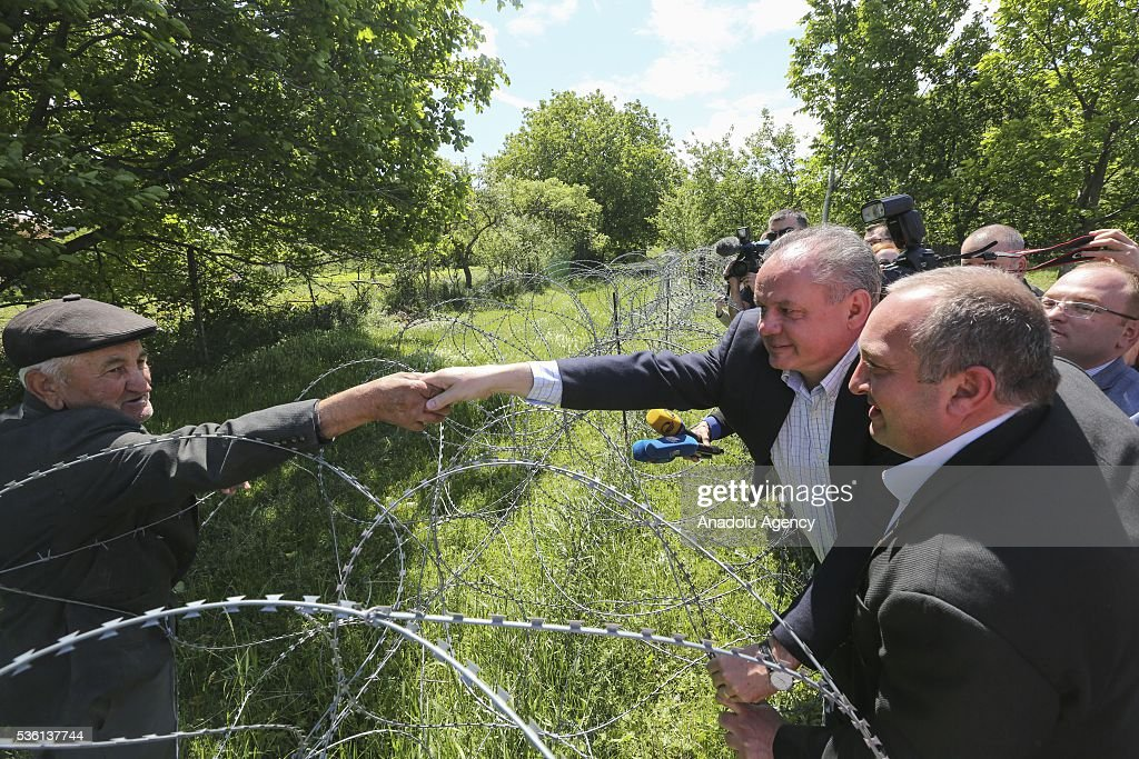 President of Georgia Giorgi Margvelashvili (R) and Slovakian President Andrej Kiska (L) visit the South Ossetia border line, controlled by occupant Russian soldiers in Shida Kartli, Georgia on May 31, 2016.