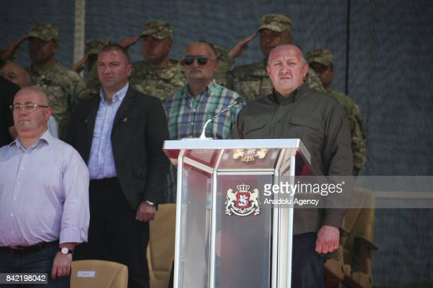President of Georgia Giorgi Margvelashvili speaks as he is flanked by Minister of Defense of Georgia Levan Izoria during the opening ceremony of...