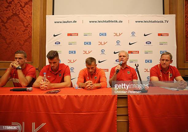 President of German track and field federation Clemens Prokop speaks at a press conference alongside athletes Pascal Behrenbruch Rico Freimuth...