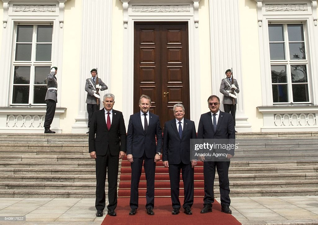 President of Germany Joachim Gauck (2nd R), Bosniak Member of the Presidency of Bosnia and Herzegovina Bakir Izetbegovic (2nd L), Serbian Member of the Presidency of Bosnia and Herzegovina Mladen Ivanic (R) and Croat Member of the Presidency of Bosnia and Herzegovina Dragan Covic (L) pose for a photograph before their meeting at the Schloss Bellevue in Berlin, Germany on June 30, 2016.