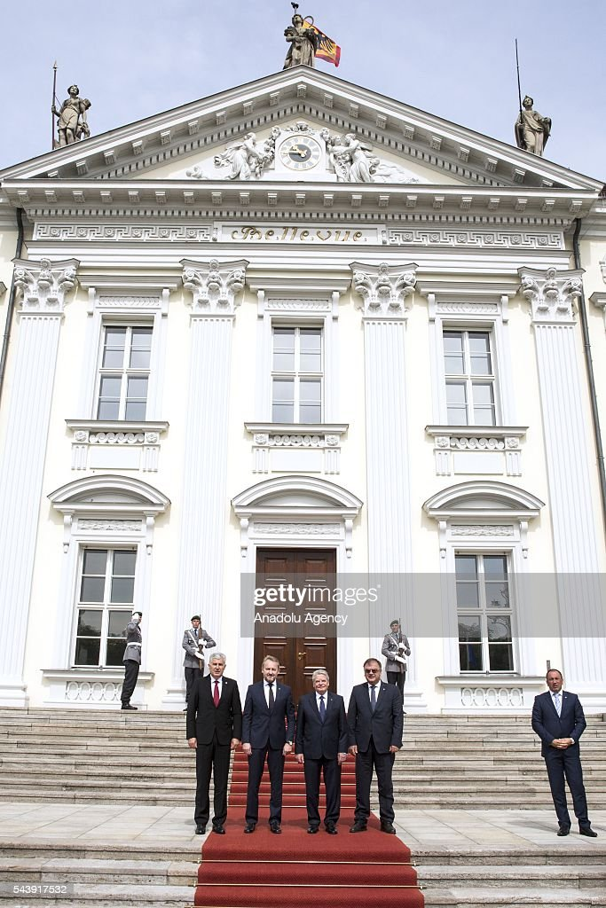 President of Germany Joachim Gauck (3rd R), Bosniak Member of the Presidency of Bosnia and Herzegovina Bakir Izetbegovic (2nd L), Serbian Member of the Presidency of Bosnia and Herzegovina Mladen Ivanic (2nd R) and Croat Member of the Presidency of Bosnia and Herzegovina Dragan Covic (L) pose for a photograph before their meeting at the Schloss Bellevue in Berlin, Germany on June 30, 2016.