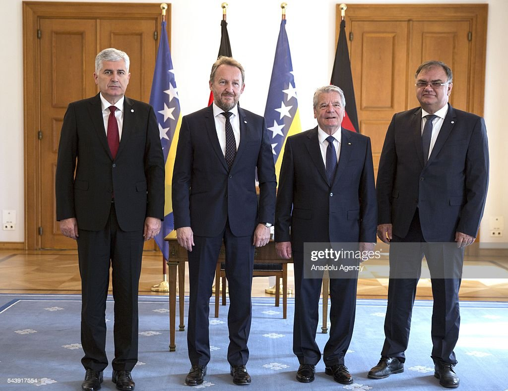President of Germany Joachim Gauck (2nd R), Bosniak Member of the Presidency of Bosnia and Herzegovina Bakir Izetbegovic (2nd L), Serbian Member of the Presidency of Bosnia and Herzegovina Mladen Ivanic (R) and Croat Member of the Presidency of Bosnia and Herzegovina Dragan Covic (L) pose for a photograph after their meeting at the Schloss Bellevue in Berlin, Germany on June 30, 2016.