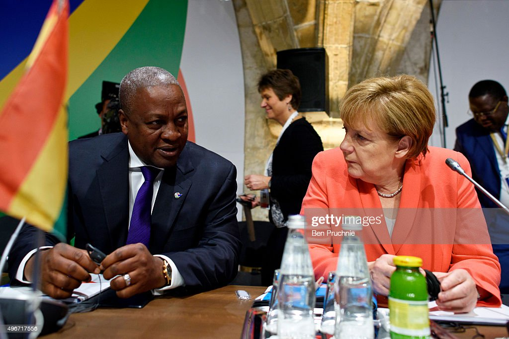 President of Ghana John Dramani Mahama and Chancellor of Germany Angela Merkel talk ahead of the first session of the Valletta Summit on migration on November 11, 2015 in Valletta, Malta. The Summit will bring together representatives from the European Union and Africa to address the challenges and opportunities presented by the largest migration of people to Europe since World War II.