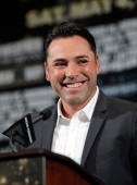 President of Golden Boy Promotions Oscar De La Hoya introduces the undercard fighters Daniel Ponce De Leon and Abner Mares during the final news...