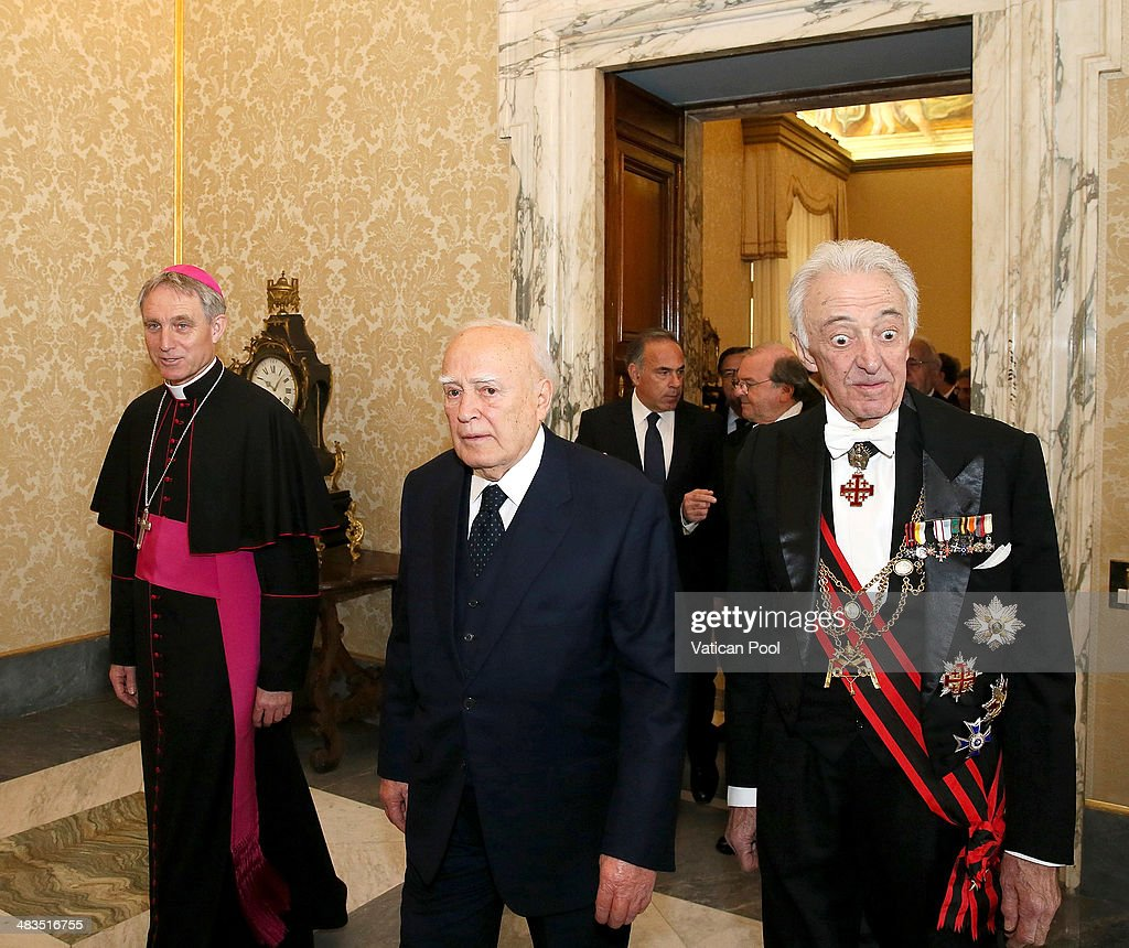 President of Greece <a gi-track='captionPersonalityLinkClicked' href=/galleries/search?phrase=Karolos+Papoulias&family=editorial&specificpeople=743016 ng-click='$event.stopPropagation()'>Karolos Papoulias</a> (C), flanked by Prefect of the Pontifical House and former personal secretary of Pope Benedict XVI, Georg Ganswein (L), arrives at the Apostolic Palace for a meeting with Pope Francis at his private library on March 28, 2014 in Vatican City, Vatican. The cordial discussions focused on issues of common interest, such as the legal status of religious communities, the role of religion in society, and ecumenical collaboration.