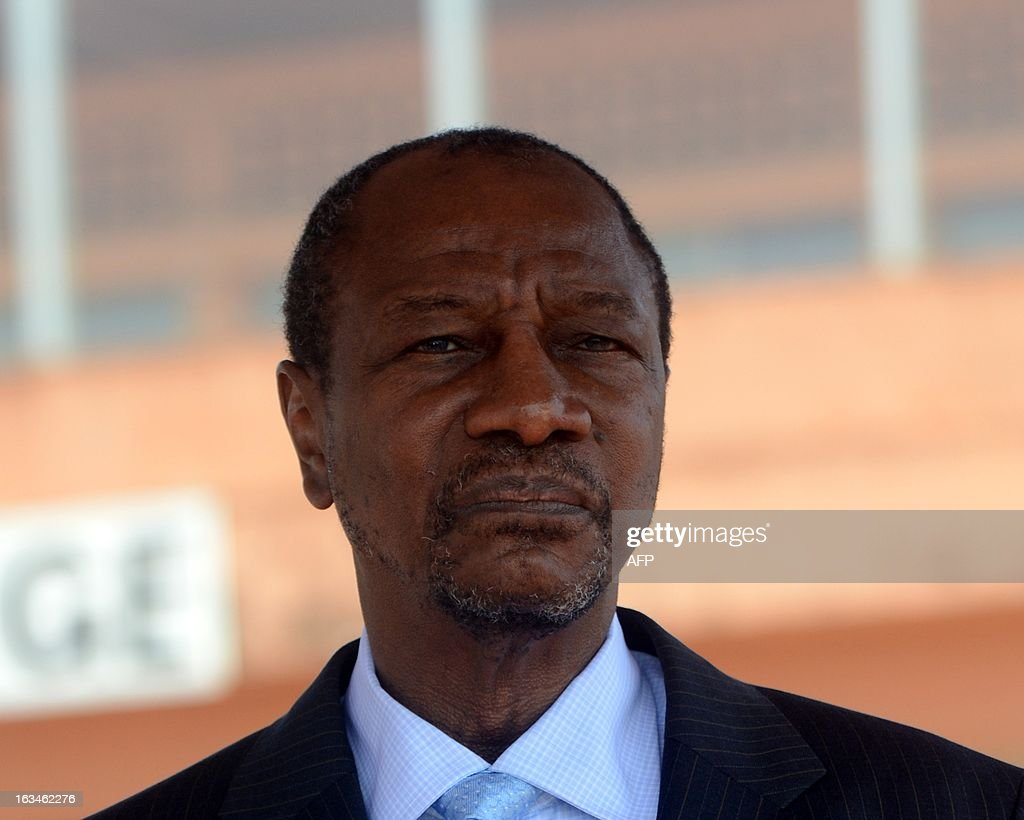 President of Guinea Alpha Conde looks on at the Conakry airport, on March 10,2013, before meeting his counterparts from Ivory Coast, Liberia and Sierra Leone, as Guinea battles unrest linked to legislative elections in May. AFP PHOTO / CELLOU BINANI