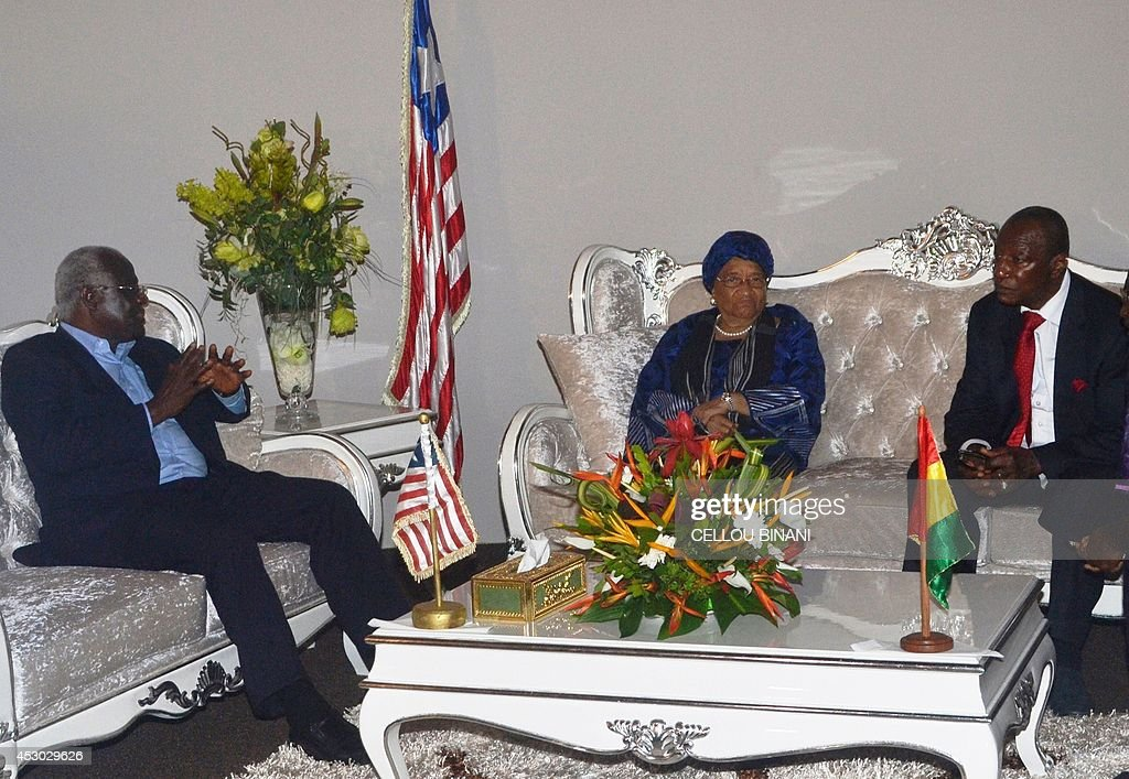 President of Guinea <a gi-track='captionPersonalityLinkClicked' href=/galleries/search?phrase=Alpha+Conde&family=editorial&specificpeople=2588606 ng-click='$event.stopPropagation()'>Alpha Conde</a> (R) welcomes his counterparts from Liberia <a gi-track='captionPersonalityLinkClicked' href=/galleries/search?phrase=Ellen+Johnson+Sirleaf&family=editorial&specificpeople=547358 ng-click='$event.stopPropagation()'>Ellen Johnson Sirleaf</a> (C) and from Sierra Leone <a gi-track='captionPersonalityLinkClicked' href=/galleries/search?phrase=Ernest+Bai+Koroma&family=editorial&specificpeople=4447998 ng-click='$event.stopPropagation()'>Ernest Bai Koroma</a>h on August 1, 2014 at Conakry's airport, prior to the opening of a summit against the fast-growing outbreak of the Ebola virus. The virus causes fever, vomiting, diarrhea and bleeding. It has killed around 60 percent of those infected since March, and taken more than 700 lives. There is no vaccine on the world market to protect against the deadly Ebola virus, but experts say the fast-growing outbreak in West Africa is speeding efforts to test one.